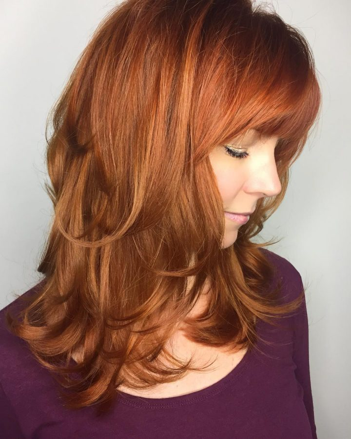 Best Layered Hairstyles With Bangs - Red Feathered Out Layers