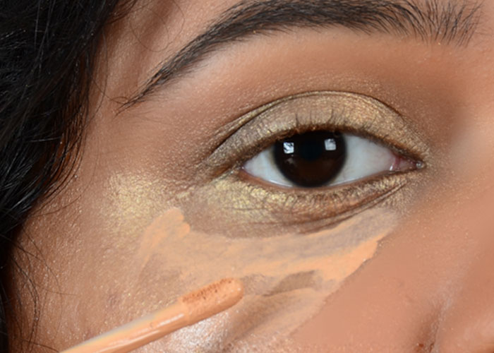 Gold Eye Makeup Tutorial - Step 5: Conceal the Heavy Fallout Areas