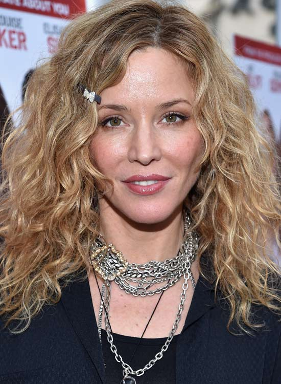 Super-Curly-Wispy-Layers-with-Small-Hair-Clip