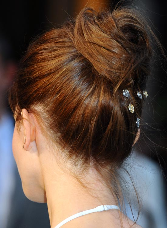 1. Twisted High Bun With Embellishments: