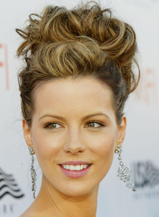 Bun Hairstyles For Long Hair - Huge-Curly-High-Bun-with-Pouf-and-Texture