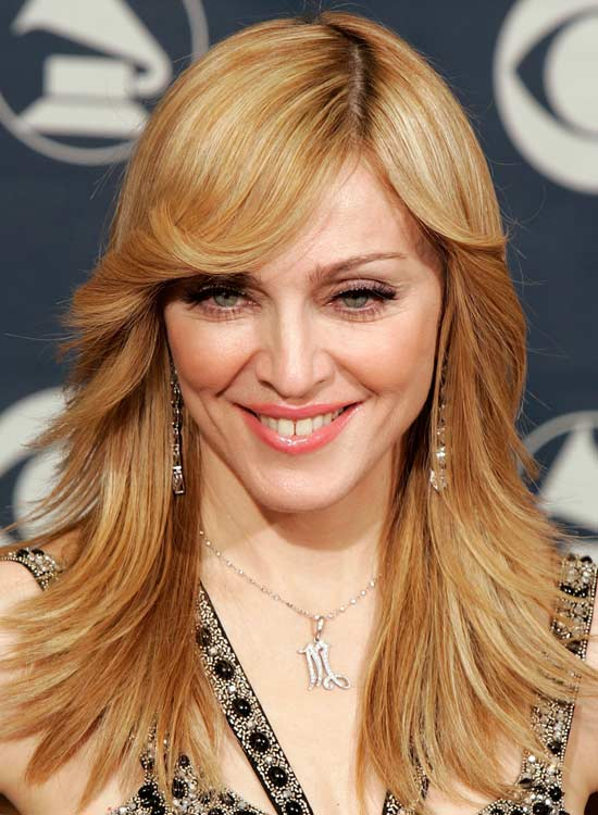 Layered-Locks-with-Curly-Side-Sweep-and-Feathered-Ends