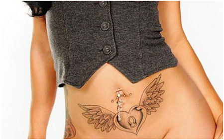 wings tattoo stomach