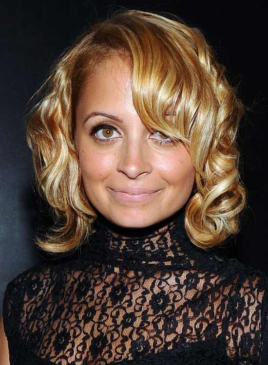 Retro-Curly-Bob-with-Dramatic-Side-Sweep