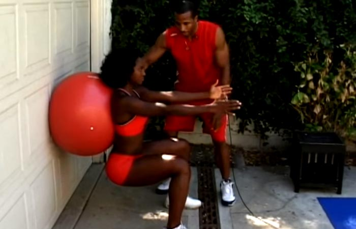 10. Wall Sit With Stability Ball