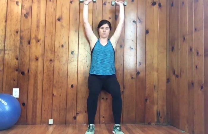 3. Wall Sit Shoulder Press
