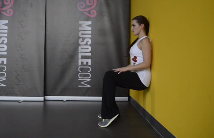 6. Wall Sit With Heel Lift