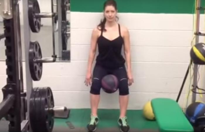8. Wall Sit With Medicine Ball