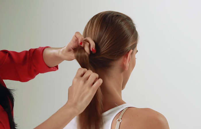 Tie-a-ponytail-to-form-the-foundation-of-your-bun