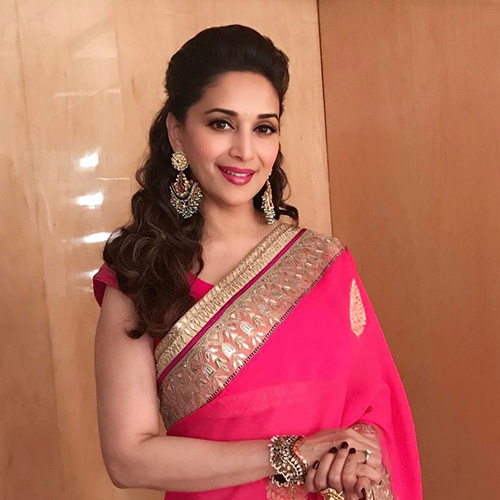 Hairstyles To Complement Your Saree - Half Up Puff